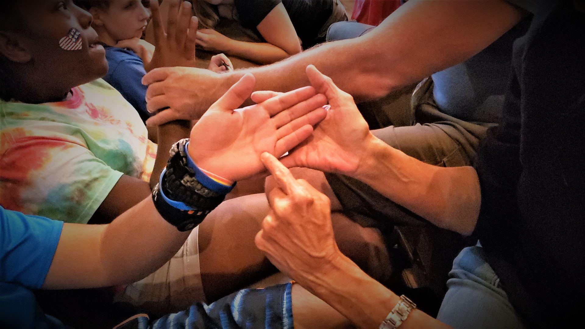DeafBlind adults socialize deafblind Jrs to protactile philosophy and language principles.