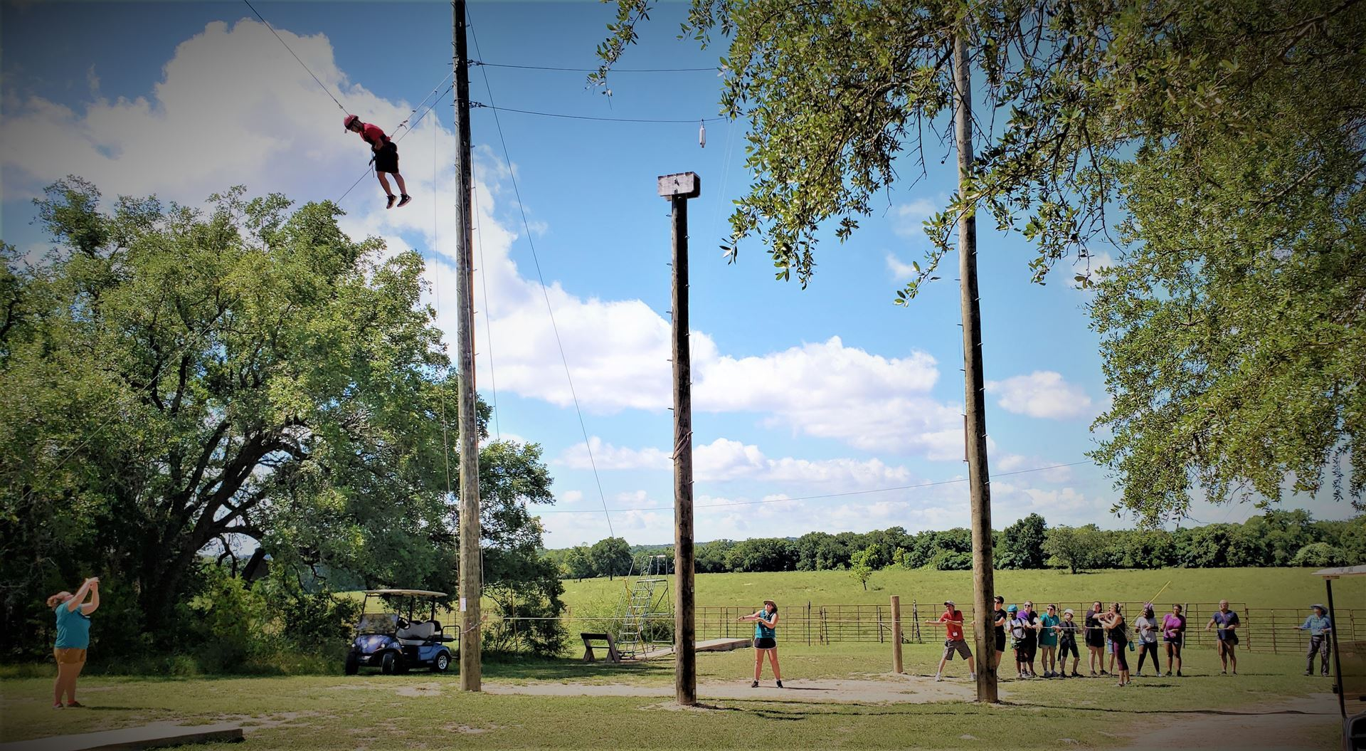 A team of Jrs, CNs and Camp Staff work together to pull a Jr 40-ft high in the sky by a rope pulley system. When he is ready, he'll let go and SWING!