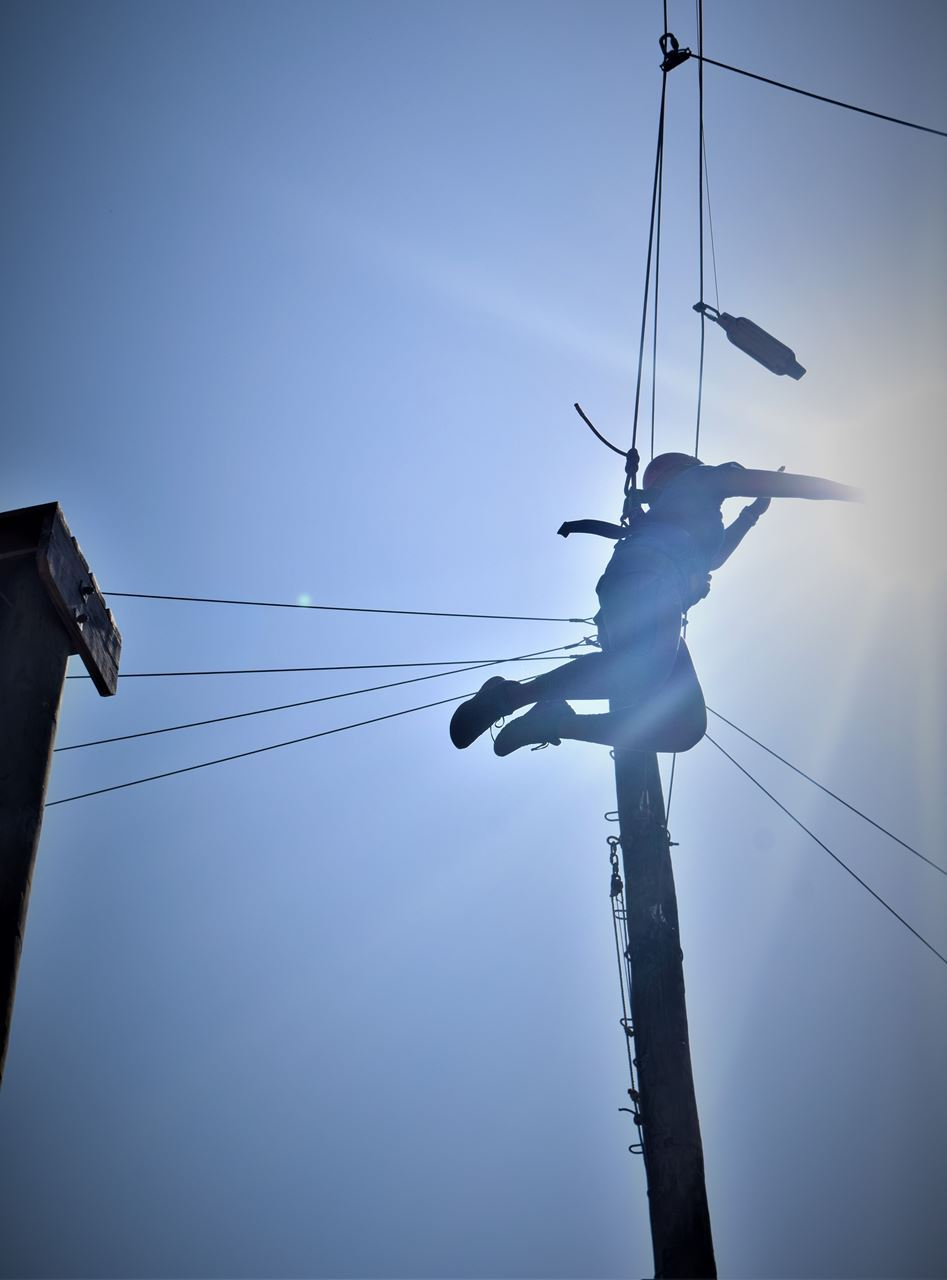 Winfield Sainpreaux jumps off the top of a 40-ft pole in the sky and successfully punches a 6-inch buoy hung from a rope, about 5 feet away from the pole. The power of the sun fills his fist.
